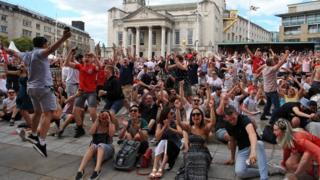 Fans celebrate England's quarter final win in Leeds
