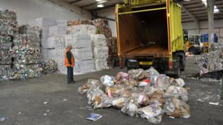 Recycling being offloaded at the States recycling site