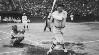 Babe Ruth hits his first home run during his tour of Japan at Miji Shrine Stadium, Tokyo, Japan