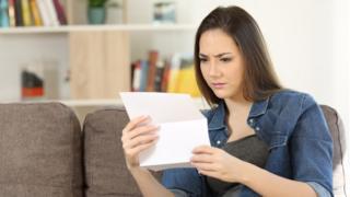 Woman looking at bill