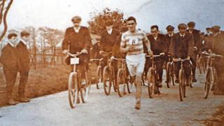 Jack Price running with cyclists