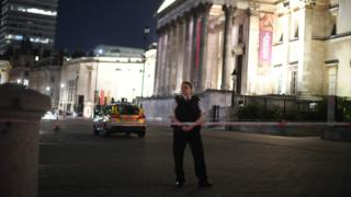 Officer standing watch at Trafalgar Square