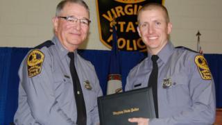 Slain officer Chad Dermyer receiving his diploma