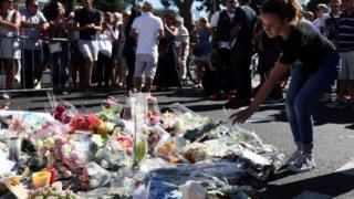 Flowers marking the death of 84 people in Nice