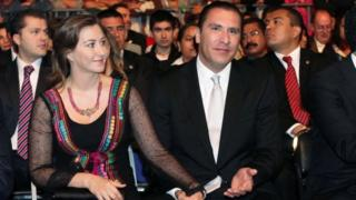 Martha Erika Alonso and Rafael Moreno Valle hold hands during an official ceremony in Puebla, Mexico. File photo