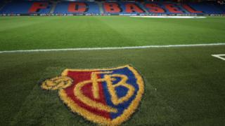 FC Basel logo on pitch