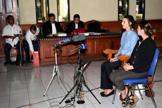 Australian woman Sara Connor, wearing a blue shirt, appears in Denpasar District Court