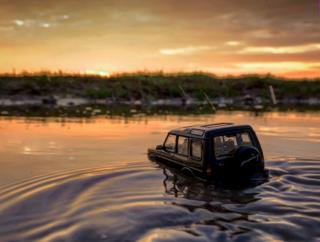 in_pictures Model Land Rover drives through a river