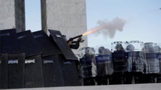 "Riot police fire tear gas toward brazilian Indians during a demonstration against the violation of indigenous people""s rights, in Brasilia, Brazil April 25, 2017"