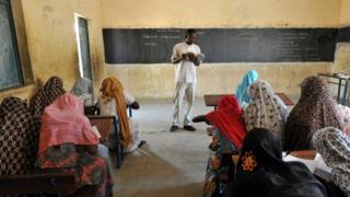 Female students in the classroom.