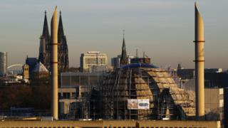 Minarets of Cologne Central Mosque are seen next to Cologne Cathedral (file pic)