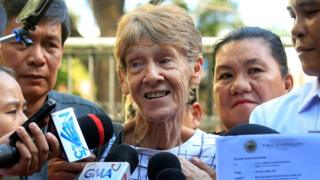 Sister Patricia Fox speaks to reporters outside an immigration bureau in Manila, Philippines