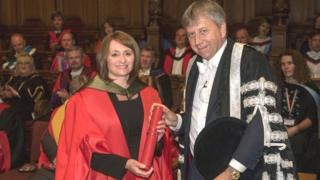 Rachel Barrie receiving her honorary doctorate from Prof Peter Mathieson of the University of Edinburgh