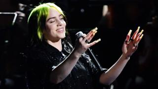 Billie Eilish performing at the Brit Awards