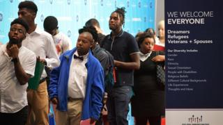 Job seekers arrive at the Walter E. Washington Convention Center for The Opportunity Hiring Fair in Washington, DC, on September 20, 2017