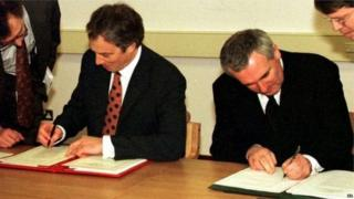 Prime Minister Tony Blair and Irish counterpart sign the Good Friday Agreement
