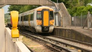 A train passes near Chartham station