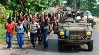 Hutu militia/French military jeep in Rwanda, June 1994