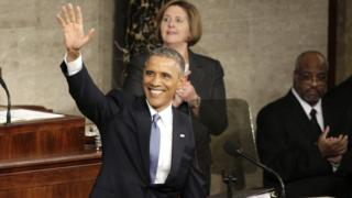 US President Barack Obama waves at the start of his State of the Union address to a joint session of the U.S. Congress on Capitol Hill in Washington in this January 20, 2015 file photo