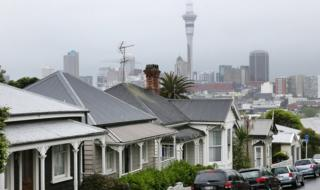 A view of a street in Auckland with the city's skyline in the background