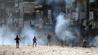 Nepalese protesters throw rocks at police during clashes near the Nepal-India border at Birgunj, some 90 km south of Kathmandu, on November 2, 2015