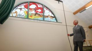 Prince Charles unveils a stained glass window at Myddfai Community Hall in Llandovery, Carmarthenshire