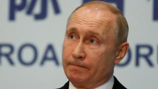 Russian President Vladimir Putin is seen at a news conference in Beijing