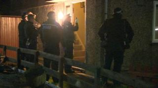Officers at a house in Glenfield where two bodies were found