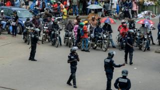Police, okada men and people for street