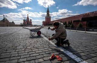 A man repairs paving stones on Red Square