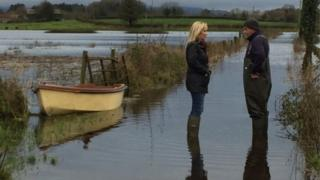 Agriculture Minister Michelle O'Neill meeting with a farmer in Fermanagh during the floods in January