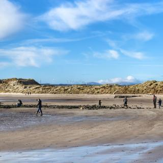 Beadnell Bay on the Northumberland Coast, with the snow dusted Cheviot Hills in the background