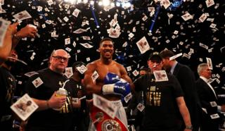 Anthony Joshua celebrates after defeating Charles Martin in April 2016
