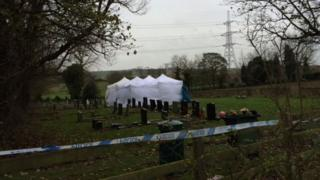 Tents and a police cordon at the graveyard