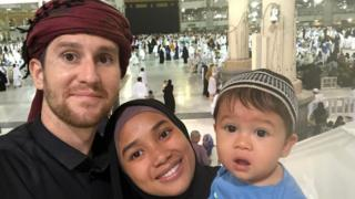 Dan with his wife and child in Mecca