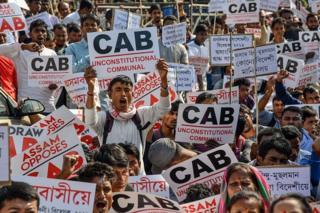 Activists of Krishak Mukti Sangram Samiti shout slogans during a protest against the government's Citizenship Amendment Bill in Guwahati on November 22, 2019