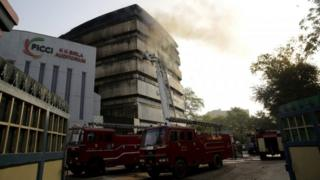 Firefighters try to extinguish a fire that broke out in the National Museum of Natural History in the Federation of Indian Chambers of Commerce and Industry (FICCI) complex in New Delhi, India, 26 April 2016.