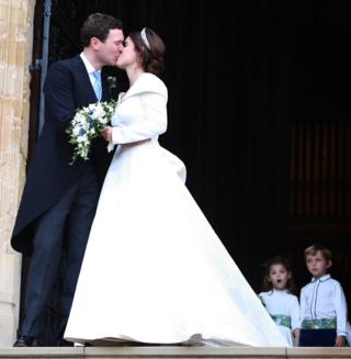Princess Eugenie and her husband Jack Brooksbank kiss as they emerge from the West Door of St George's Chapel, Windsor Castle
