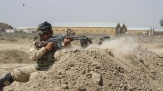 Iraqi troops train with US soldiers at the Taji base. File image