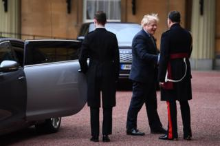 Prime Minister Boris Johnson arrives at London's Buckingham Palace for an audience with Queen Elizabeth II