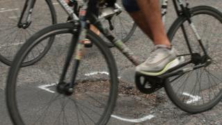 A bike going over a pothole