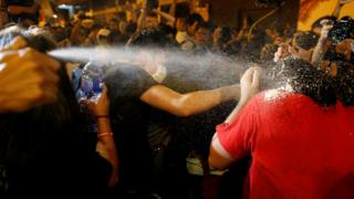 Protesters are pepper sprayed by police during a protest in Hong Kong