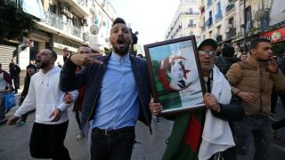 Algerian protesters chant slogans during a demonstration protest against the fifth term of Abdelaziz Bouteflika