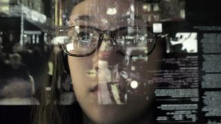 Young woman looking at touch screen