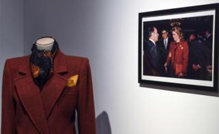 An Yves Saint Laurent coat displayed at the Christie's auction house in Paris on January 18, 2019