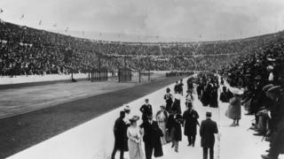 Black and white photograph shows crowds gathering at the first modern Olympic Games in Athens