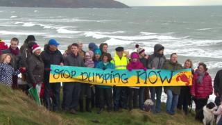 Protestors holding a banner near Tregantle Fort