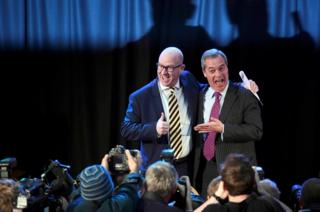 United Kingdom Independence Party (UKIP) interim leader Nigel Farage (right) embraces newly elected leader Paul Nuttall in London