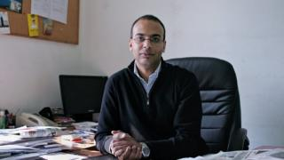 This photo from 7 December 2011, shows Hossam Bahgat in his office at the Egyptian Initiative for Personal Rights in Garden City, Cairo, Egypt.