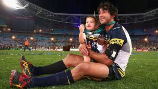 Cowboys captain Johnathan Thurston takes a moment in the centre of the field with his daughter Frankie Thurston at ANZ Stadium on 4 October 2015 in Sydney, Australia.